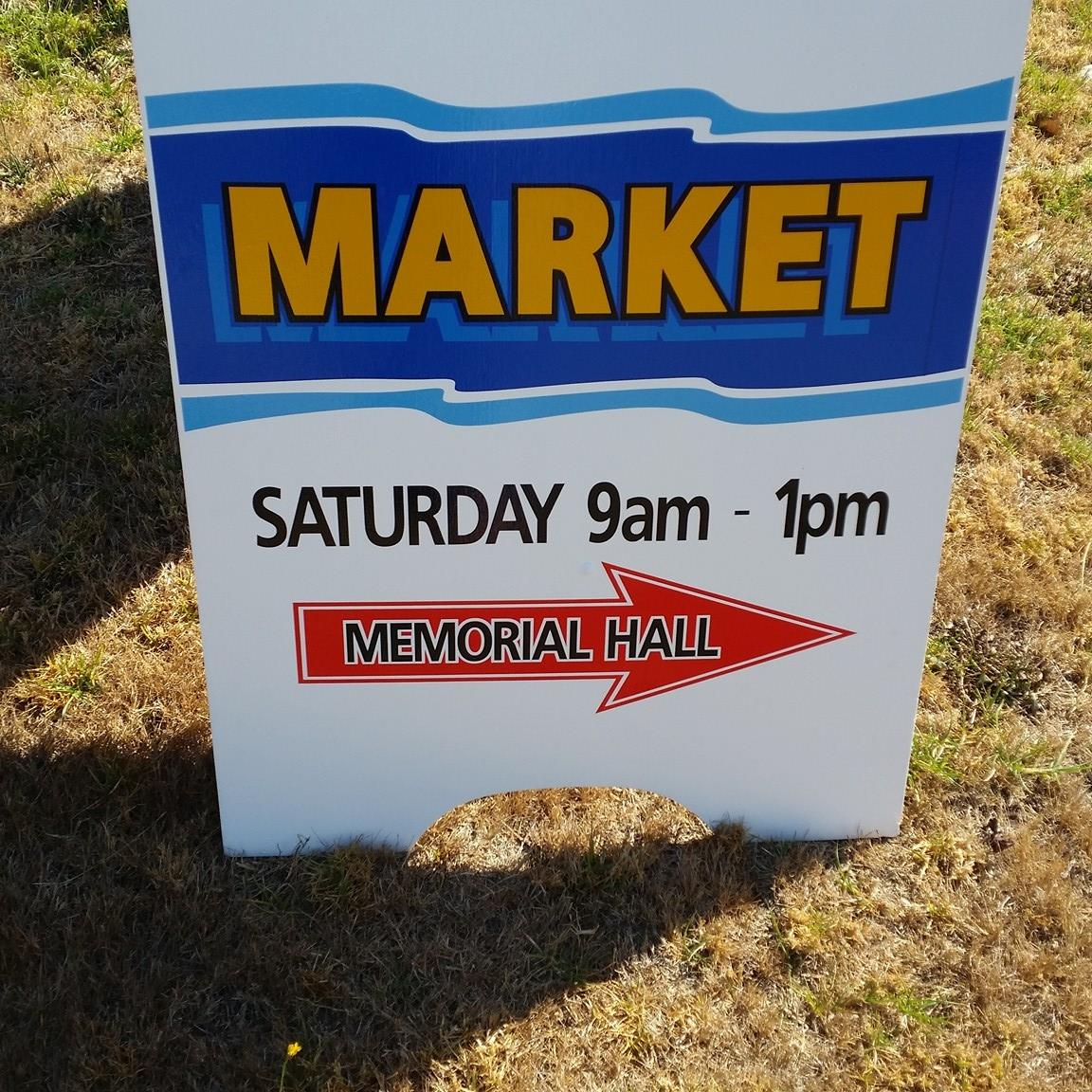image of a sign. Market Saturday 9am to 1pm. Memorial Hall